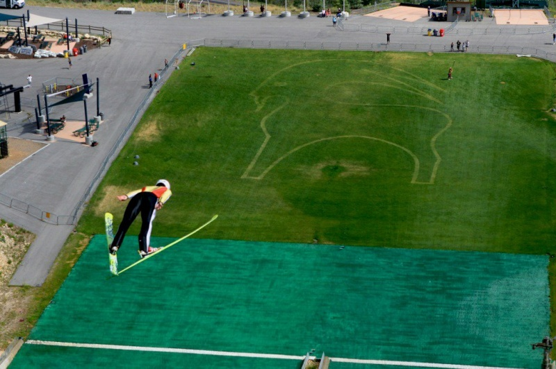The Backcountry.com Goat logo is depicted in the outrun area as U.S. Ski Jumping athletes train this summer at Utah Olympic Park. (photo: USASJ)
