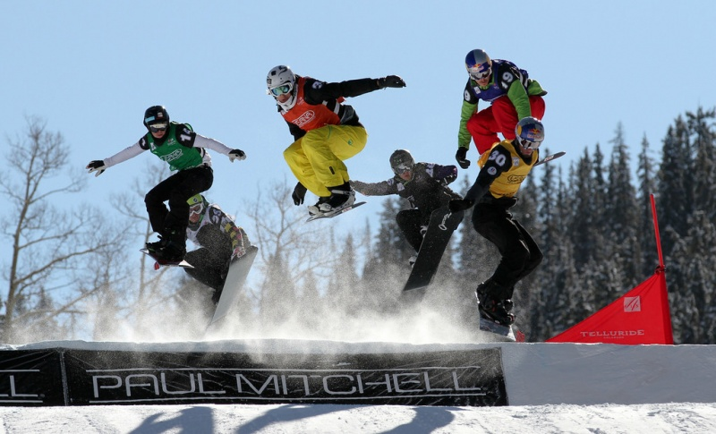 Action during the 5th men's heat at Friday's World Cup Snowboardcross in Telluride, Colo. Pierre Vaultier (FRA) yellow, Stian Sivertzen (NOR) red, Alex Pullin (AUS) blue, Elias Koivumaa (FIN) green, Hanno Douschan (AUT) black, Nikolay Olyunin (RUS) white. (photo: FIS/Oliver Kraus)