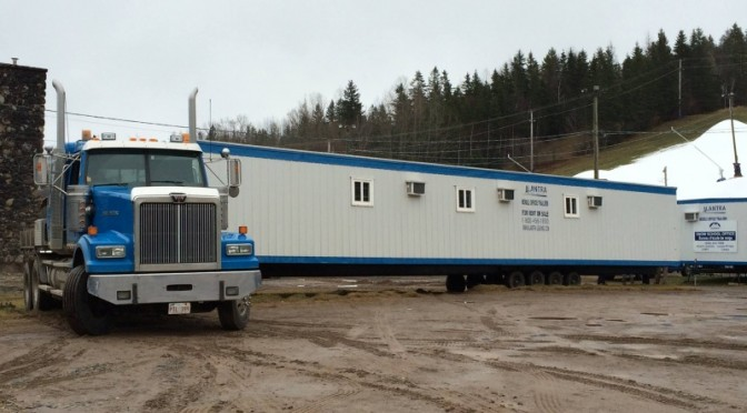 Temporary trailers have begun arriving at Poley Mountain to replace the ski resort's base lodge that was destroyed by fire earlier this month. (photo: Poley Mountain)