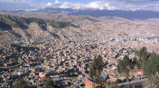 The flat-topped crest of La Mururata can be seen on the horizon on right in this photo of La Paz, Bolivia, the world's highest capital city. (file photo: Phil Whitehouse)