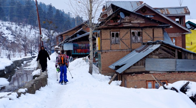 Tom slides through the quiet village of Tangmarg. (photo: FTO/Matt Clark)