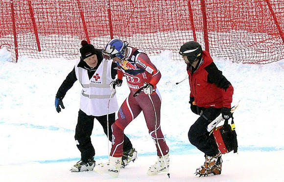 Norway's Aksel Lund Svindal is assisted by medical staff after crashing during the men's downhill race of the Audi FIS Ski World Cup in Kitzbuehel, Austria, last January. (photo: Getty/AFP-Robert Jaeger via USST)