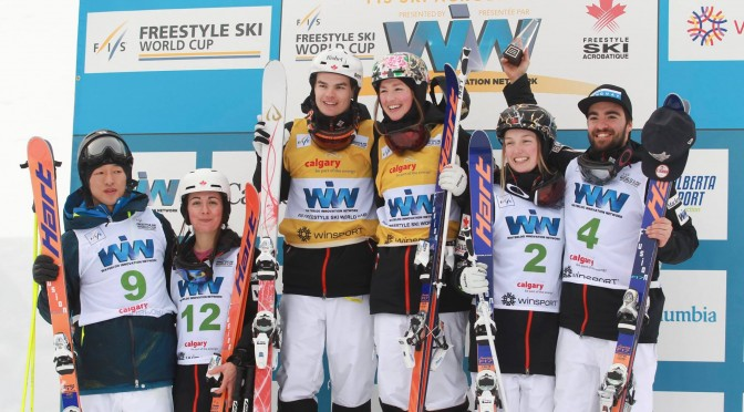Five Canadians stand on the FIS Freestyle Ski World Cup Moguls podium in Calgary, Alberta on Saturday. (photo: Mike Ridewood / Canadian Freestyle Ski Association)