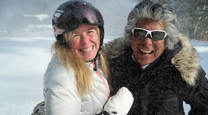 1988 USA Olympian skier Pam Fletcher and freestyle ski pioneer Wayne Wong pose under snow guns during Wong's 2016 annual visit to Nashoba Valley Ski Area in eastern Massachusetts. (photo: FTO/Martin Griff)
