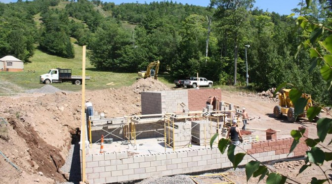 Construction continues on Mount Bohemia's new log cabin bar/hostel. The uptairs will feature a log cabin bar with outdoor hot tub, and the lower level will house a 24-bed hostel. (photo: Mount Bohemia)