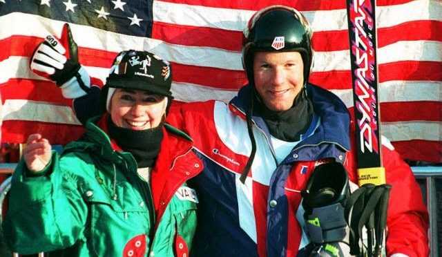Tommy Moe stands with Hillary Clinton in the finish area of the Olympic men's downhill in Kvitjell, Norway, in 1994. (file photo: Getty Images-Jean Loup Gautreau via USST)