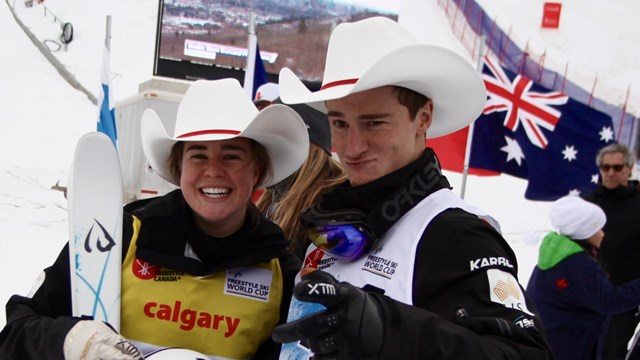 Australians Britteny Cox and Matt Graham get into the Calgary spirit on Saturday. (photo: FIS/Buchholz)