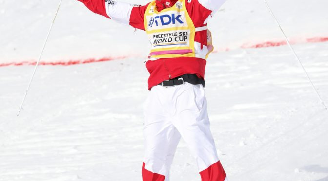 Canada's Mikael Kingsbury celebrates another World Cup moguls victory on Saturday in Japan. (photo: FIS)