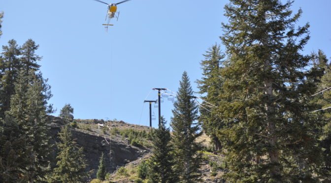 A helicopter assists construction workers building Bear Valley's new high-speed six pack. (photo: Bear Valley Resort)